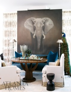 """The dining area features the Baobab Table by Jiun Ho Collection and a Monte Carlo Settee by Initials Furniture. The wallcovering in the lounge is Kyle Bunting""""s Jet Stream in platinum."""