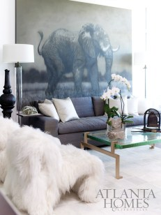 """Soft, sensuous and glamorous describes the main living area. Promenade Rug in cream by Kyle Bunting. Furry Chairs by COUP Studio. The Nolita Sofa and Jewel Coffee Table are by Magni Home. Chip &""""Company provided the bronze Thai elephant bell and stone bird on the coffee table, as well as the black Thai finial and iron drink table. Sao Paulo Floor Lamp by BroadBeach. All of these items are available through R Hughes."""