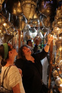 Susan Ferrier examines pierced metal lanterns.
