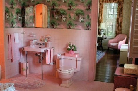 """Vintage wallpaper and bubble gum pink tiles were used for Hilly Holbrook""""s bathroom."""