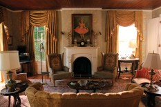 """Production Designer Mark Ricker scoured Memphis and nearby towns in Mississippi for antiques to use in spaces such as Hilly Holbrook""""s living room."""