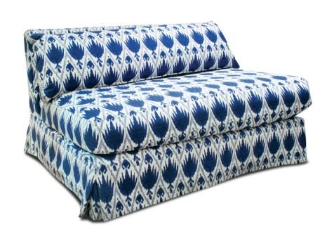 "Jonathan Adler ""Kirby slipper chair and a half"" in Aegean Sea, $2,650. Available at Jonathan Adler, 1198 Howell Mill Rd., Atlanta 30318"
