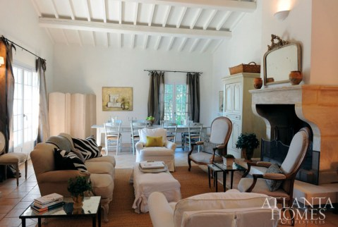 The living room of Les Murets, an enchanting estate where travelers on the immersion excursions take up residence for a blissful seven days, overlooks the olive trees and lavendar fields surrounding the property.