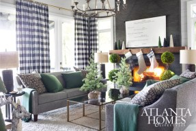 Flynn turned scripts from his favorite holiday movies into seasonal decor by printing them on canvas and hanging them on drapery rods as scrolls. Walnut mantel, Grey Furniture. Tweed sofas, Mitchell Gold + Bob Williams.