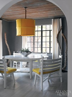 The dining room in her home features a picnic table and benches that she purchased during a buying trip in France.