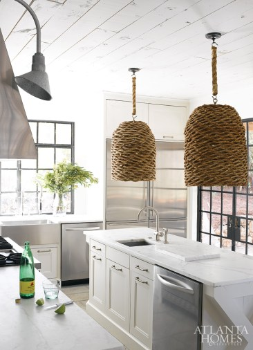 Stainless steel appliances and white surfaces give Douglass' kitchen a very clean, modern appearance. The basket-style hanging fixtures are quintessential South of Market.