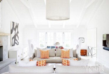 """The homeowners, parents to three young children, loved the floor plan of the classic estate home, but wanted to update it with """"fresh, modern flair,"""" says designer Kay Douglass. The family room is refreshingly clutter-free; here, """"overscaled pieces help create a simplified and harmonious, yet practical, environment for a young family,"""" she says."""