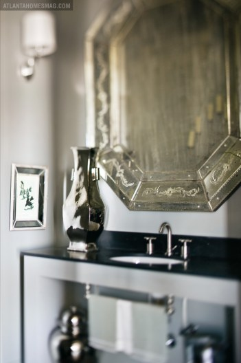 Bathroom fixtures from Renaissance Tile & Bath are elegant in their own right, but finishing touches like this Venetian mirror up the ante further.