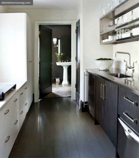 With open shelving and contemporary painted oak veneer cabinetry for extra office storage, the galley kitchen exhibits maximum style and efficiency.