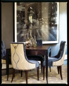 The modern lines of a leather-topped game table are the perfect counterpart to the shapely silhouettes of the chairs that accompany it.