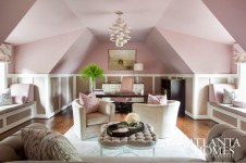 Thanks to the perfect splash of pink (Sherwin-Williams Dressy Rose), Boyd fashioned this office and retreat for the hardworking lady of the house. The space is adorned with art from Pryor Fine Art.