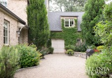 This English Manor-style home is the result of collaborative efforts by Harrison Design, R.J. Stewart Inc., landscape architect John Howard and SmithBoyd Interiors. A lushly lined courtyard, swimming pool and adjacent brick pavilion with cedar beams contribute to a feeling of privacy and seclusion.