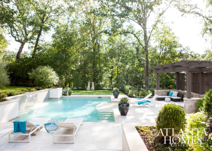 Poolside, chaises from Design Within Reach and an Allegro Classics sectional provide space to lounge.