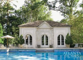 """This classic pool house was created in the midst of a lengthy design process for a large Atlanta residence. """"The clients had called from France to say that they had just purchased 'parts of a French building made of stone with a very charming pedimented entrance way with carved grape vines,'"""" he recalls. While the discovery did not prove right for the front door, it did make for the perfect focal point above the central pavilion of the structure."""