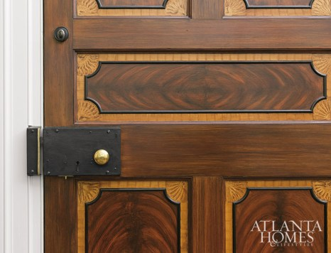 This newly constructed front door was faux painted to resemble high-style 18th-century English and American prototypes. The authentic lock box is an antique from Pennsylvania.