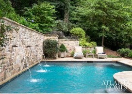 Understated landscaping and hardscaping by the pool, added three years ago by landscape architect Ed Castro, have matured into an elegant and complementary setting.