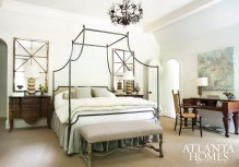 The master bedroom boasts forged-iron Niermann Weeks custom bedside chests and a handsome heirloom writing desk. A crystal Currey & Company chandelier sparkles from above, completing the mix of masculine and feminine.