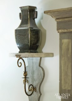 Rustic vessels from Webb-Marsteller are perched upon brackets culled from A. Tyner antiques.