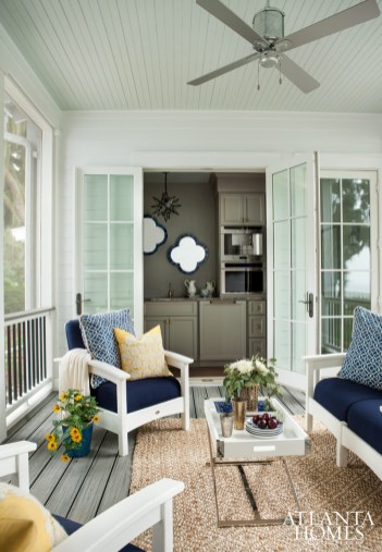 The guest retreat, boasting its own butler's pantry, is connected to the main house through a screen porch that features plush Trex furnishings and picture-perfect views.