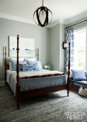 A woven rug from Scout in Beaufort, SC, anchors a guest bedroom.