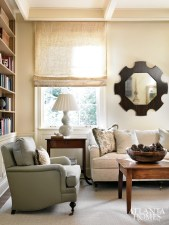 A sitting room beckons with sumptuous seating and a touch of pattern from accent pillows covered in Vaughn, Cowtan & Tout and Jane Shelton fabrics. Sheer Roman shades by Hinson.