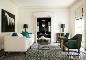 """With a belief that """"you can do a fabulous house and not leave Atlanta,"""" the designers shopped locally for most of the home's furnishings. Vintage Maison Jansen cocktail tables and matching chests were found at Jane Marsden Antiques (a treasure trove, says Margaret), while the armchairs, upholstered in a Jim Thompson silk fabric, were purchased at Belvedere."""