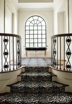 Margaret chose a now-discontinued Schumacher zebra-striped stair runner for her previous clients. The black-and-white animal print works just as well among its updated surroundings as it did in the home's former scheme