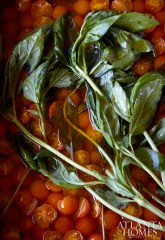 A bumper crop of Sungold tomatoes was seasoned with slivered garlic, salt and fresh basil.