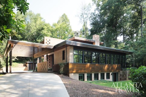 Originally designed by renowned Bauhaus-trained architect and Holocaust hero Andre Steiner, this hillside house-re-imagined by architect Frank Neely and interior designer Amy Morris-bears his signature perforated brick, extended overhangs and ribbon windows.