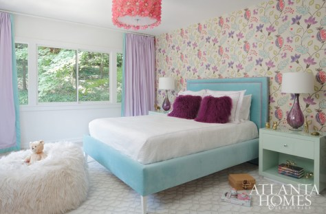 A vision in precious pastels, one of the twin girl's bedrooms was influenced by Osborne & Little's botanical wallpaper. Nightstands from Worlds Away. Rug, Causeway Collection, by Ulster Carpets.