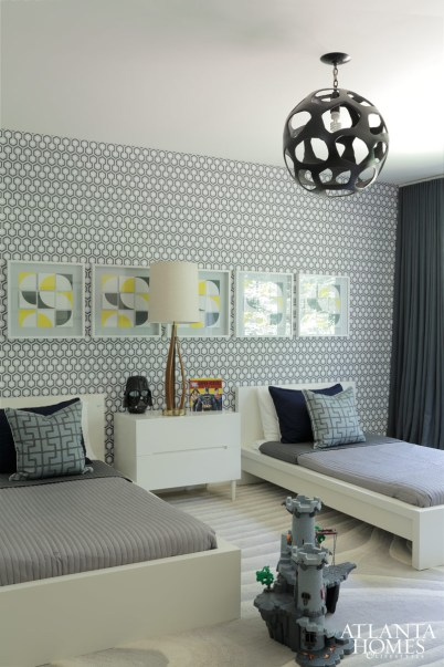 A charming study in geometry, this boy's room is wrapped in Cole & Son Wallpaper. The sleek furnishings are from Ikea, and a pendant was found at Arteriors.