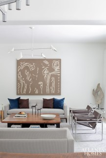 The living room opens to the dining room and expansive backyard. Art from Bill Lowe Gallery. Custom sofas by TecnoSedia.