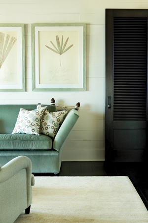 A ratchet-arm sofa in the master bedroom's seating area is swathed in a soothing blue mohair. It's comfortable and more than sturdy enough to stand up to beach house living.