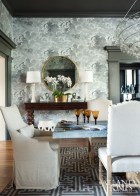 An entrancing Cole & Son wallpaper in the dining room depicts stormy skies.