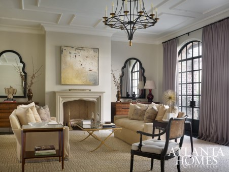 Grand steel-and-glass doors, a Dessin Fournir chandelier and a geometric ceiling motif add intrigue in the formal living room. Drapery, Rogers & Goffigon. Mantel, François & Co.