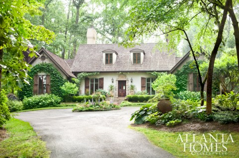 Located on 10 acres of land just outside the city, this home's charming facade and gardens create a warm welcome.