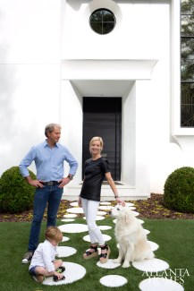 Kevin and Lee Kleinhelter, alongside 5-year-old son Holden and golden retriever Rider, lounge around their labor of love—a 4,160-square-foot Brookwood Hills showstopper the design-minded couple built from the ground up.