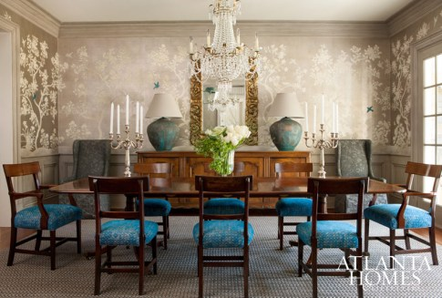 Designer Will Huff upholstered the dining room chairs in Sabina Fay Braxton's textiles to satisfy Cara Isdell's taste for the Parisian. A Gracie wallpaper, complete with hand-painted blue birds, adds an extra dose of romance.