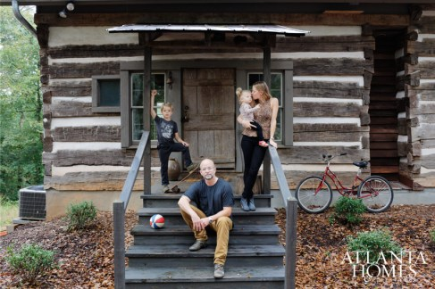 Jim, Kimberly, Ellis and Luca in front of Jim's photography studio.