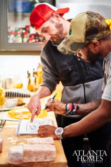 Chef Tyler Williams and Andre Brookins prepping for the five-course meal from the kitchen.