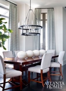 """""""The clients did not want a stuffy dining room and wanted all the chairs to be the same, so the feeling was of equality and comfort,"""" says DeLoach. """"The large table needed an equally large chandelier to match the scale."""""""