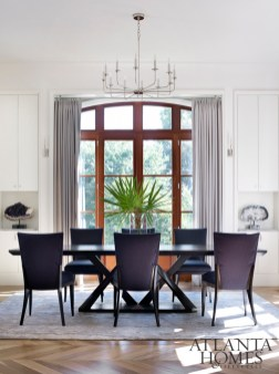 Dakota Jackson chairs surround a Hellmann-Chang table in the dining room, while Holland & Sherry wool draperies frame the view.