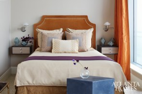 A velvet headboard is the focal point in a guest bedroom; floating drawers create the illusion of space.