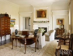 Contemporary elements, such as the rug from Moattar, a tufted chair from Travis & Company and wool draperies from Clarence House, balance the living room's antiques.