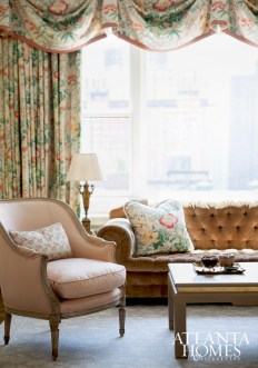 Living room draperies by Brunschwig & Fils add a decorative punch above the Scalamandré velvet tufted sofa.