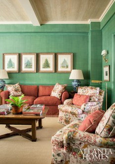 Decorative paint in a green linen finish adds a contemporary element to the family room, where a Cowtan & Tout chintz injects a traditional feel.