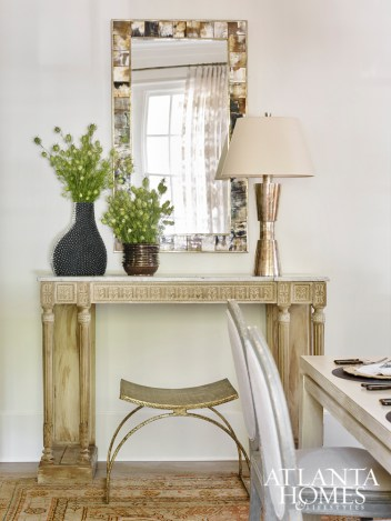 A French console, graphic horn mirror and gilded iron stool also bring the designer's signature style to life.