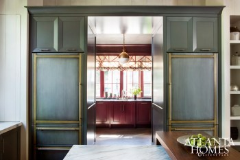 Quinn designed the butler's pantry to overlook the pool. He selected the pomegranate color to contrast with the cabinets in the kitchen.