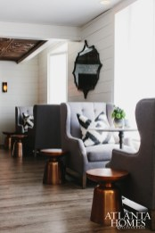 Designer Kelly Wolf Anthony created an airy and sophisticated feel with clean lines, whites and dark woods.