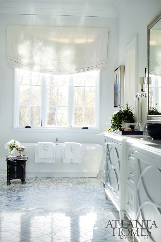The master bath feels downright ethereal thanks Carrara marble floors, polished marble counters and nickel faucetry.